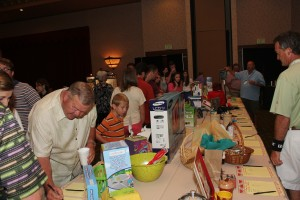 Guests look over items at silent auction that helps fund scholarships at local technology centers.