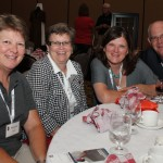 BASCO's Rhonda Trower, left, enjoys time last year at the convention with her associate Linda Moline and Kent Carter's group from Oklahoma Mortgage Banker's Association