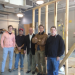 File photo of OSHBA Associate member Mark Preiss with the building trades group at Tulsa Tech. They were readying for state competition by practicing on a building unit.