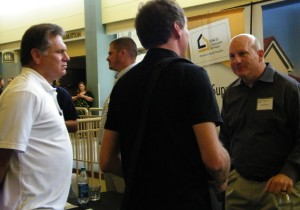 Steve Moore, left, and Dan Dressen with MASCO consult with builder David Wanzer
