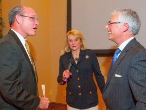 Gov. Fallin congratulates new president of the state's home builders association Todd Booze, left, with Oklahoma State Home Builders Association Executive Vice President Mike Means, right.