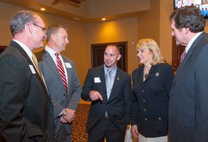 Jeff Click of Edmond, center, outgoing president of the state home-builders organization, chats with Gov. Fallin and her husband, Wade Christensen, right. Current president Todd Booze, left, and Curtis McCarty, both of Norman.