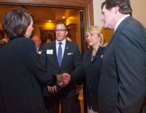 Home Builder Kurt Dinnes of Norman introduces wife Megan to Gov. Fallin and husband Wade Christensen, right.