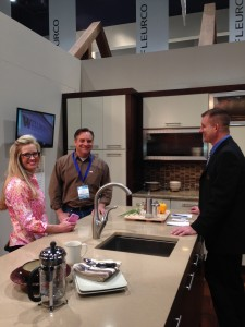 Michelle and Aaron Tatum of OKC, left, talk with a vendor about outdoor kitchens.