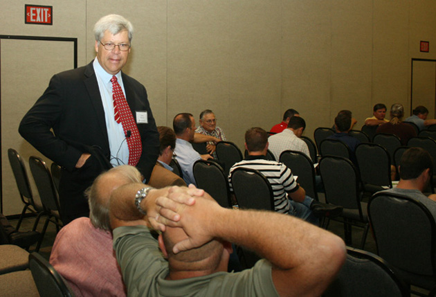 Chris Ramseyer visits with members of the audience at the start of his presentation.