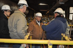 Acme Plant Manager John Spence explaining the science behind the making of bricks.