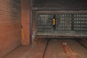Coming out of the kiln. That is fire in between the bricks in the 1800 degree kiln.