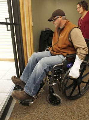 Home builder David Bryan tries to maneuver a wheelchair through a door way during a Certified Aging-in-Place class PHOTO BY PAUL HELLSTERN, THE OKLAHOMAN PAUL HELLSTERN - Oklahoman
