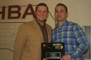 Andy Hammons (l) presents the president's plaque to Jake Clanin (r).