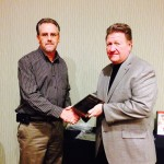 Tim Lederer presents Colin Hawkins as the Builder of the Year