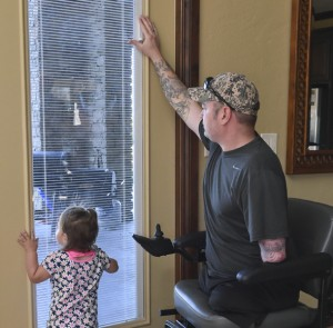 Facing eastwardly from the Great Room, the French doors are double-paned with low-E glass and have center blinds. The lever is set out of the reach of the Dunagan's 18-month-old daughter. Photo provided by Shannon Comman