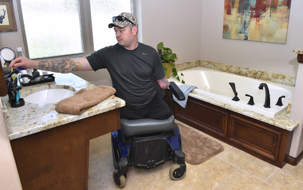 Disabled Army vet Rusty Dunagan moves around with ease in his new master bathroom. Photo provided by Shannon Comman