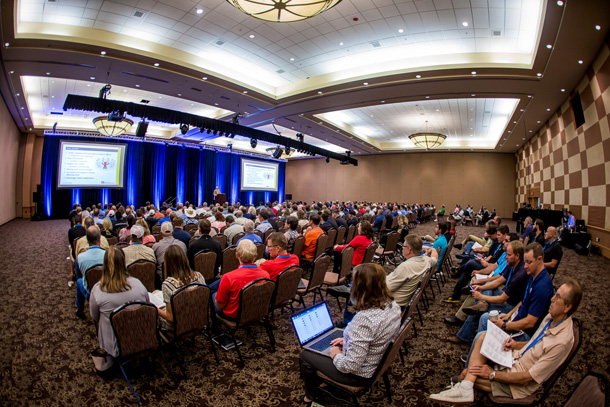 A packed Opening Session audience listens to keynote speaker Charles Shinn at the 2015 Oklahoma Building Summit & Expo.